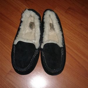 Black, fuzzy, Ugg loafers.
